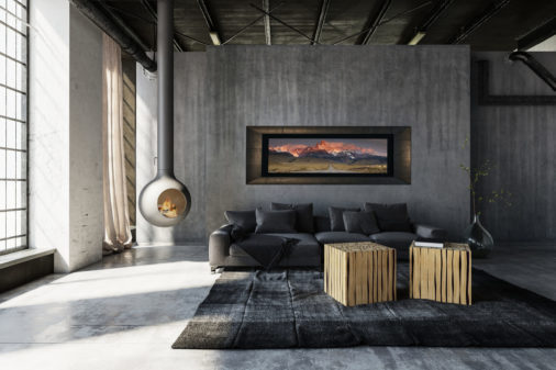 framed photo of road leading to mountains in Patagonia displayed in living room of modern luxury home