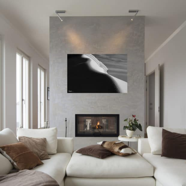 large black and white photo of iceberg in Antarctica displayed in living room of modern luxury home
