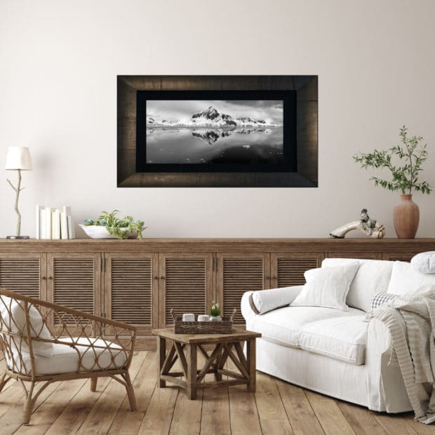 framed photo of mountains and ice in Antarctica displayed in living room of modern luxury home