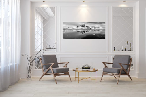 photo of mountains and ice in Antarctica displayed in living room of modern luxury home