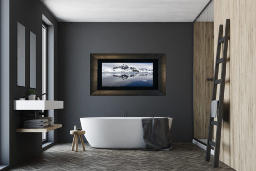 framed photo of ice and mountains in Antarctica displayed in bathroom of modern stylish home