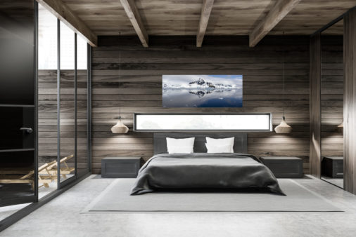 large photo of ice and mountains displayed in bedroom of modern luxury home