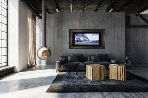 framed photo of sailboat navigating ice in Antarctica displayed in living room of modern luxury home