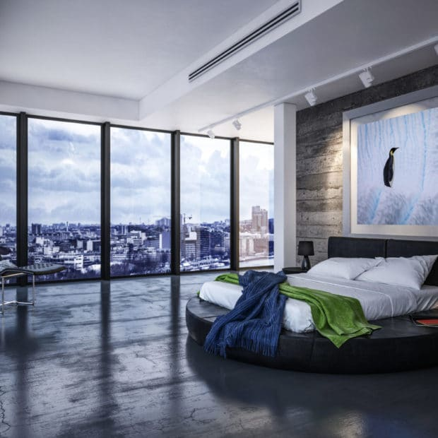 framed large photo of emperor penguin displayed in luxury city apartment bedroom