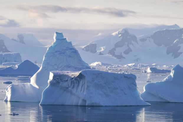sunrise on mountains and icebergs in Antarctica