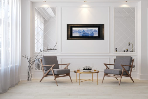 framed photo of ice and mountains in Antarctica displayed in living room of modern luxury home