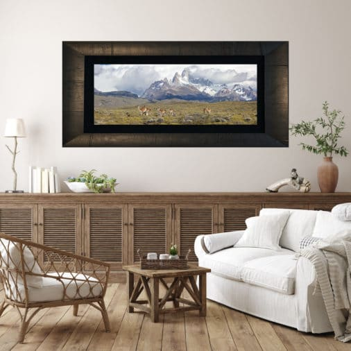 framed photo of wildlife crossing in front of mountain in Patagonia displayed in living room of luxury home