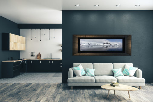 framed photo of mountain and ice in Antarctica displayed in stylish modern home