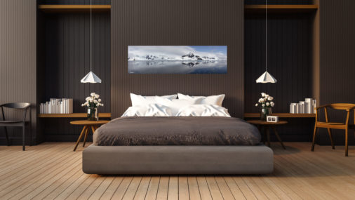 large panoramic photo of ice and mountains in Antarctica displayed in bedroom of luxury home