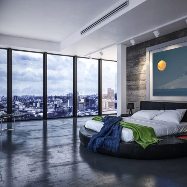 Framed photo of moon rising over mountains with a whale jumping deployed in a modern city apartment