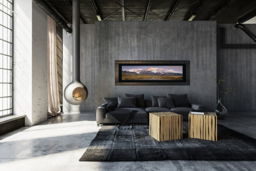 framed photo of road leading to Patagonian mountains displayed in modern luxury living room