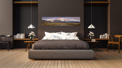 photo of road leading to mountains displayed in bedroom of luxury home
