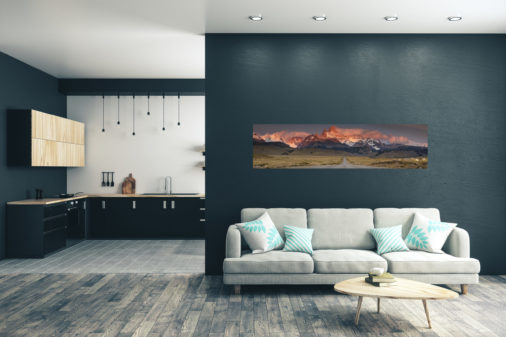 panoramic photo of a road leading to Patagonian mountains displayed in living room of modern luxury home