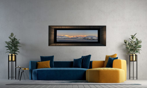 framed panoramic photo of sunset across mountains in Antarctica displayed in living room of modern luxury home