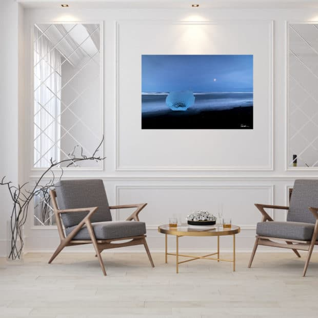 large fine art print of ice on black sand beach in Iceland displayed in modern stylish luxury home