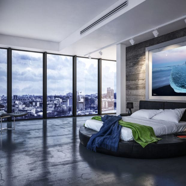 large photo of glowing blue ice on black sand beach in Iceland displayed in bedroom of modern luxury city apartment