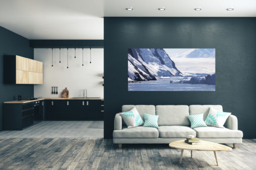 photo of a sailboat navigating ice in Antarctica displayed in living room of modern luxury home