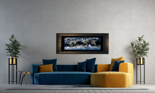 framed photo of chinstrap penguins displayed in living room of modern luxury home