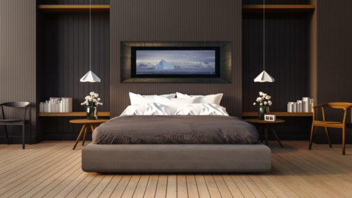 framed photo of massive icebergs floating in Antarctica displayed in bedroom of stylish home