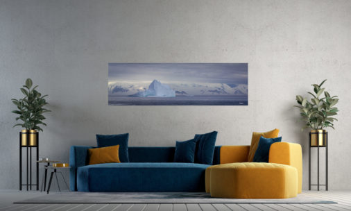 photo of massive icebergs floating Antarctica displayed in living room of modern luxury home