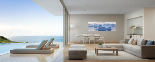 photo of ice and mountains in Antarctica displayed in dining room of luxury ocean side