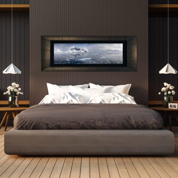framed photo of mountains and ice displayed in bedroom of stylish luxury home