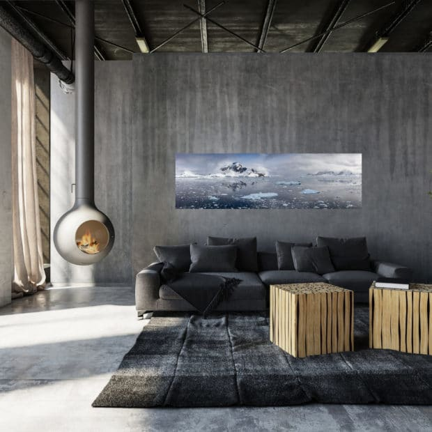 large panoramic photo of mountains and ice displayed in living room of modern luxury home