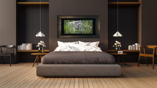 framed large fine art print of elephant in borneo walking through tall grasses displayed in modern stylish luxury home