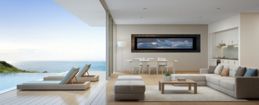 framed photo of icebergs in Antartica displayed in dining room of luxury ocean side mansion