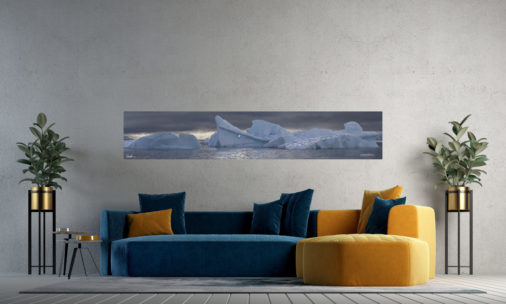 large panoramic photo of icebergs floating in Antarctica displayed in living room of modern stylish home