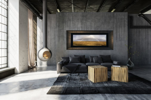 framed photo of rainbow over golden field in Iceland displayed in modern stylish luxury home