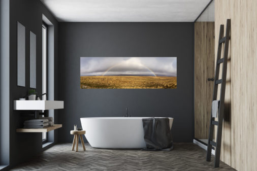 panoramic fine art print of rainbow over golden field in Iceland displayed in modern stylish luxury home