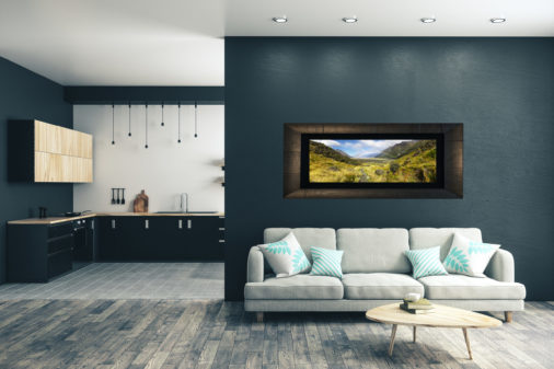 framed fine art print of mountain valley in New Zealand with a rainbow cutting across the valley displayed in modern stylish luxury home