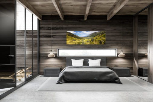 photo of a mountain valley in New Zealand with a rainbow cutting across the middle displayed in modern stylish luxury home