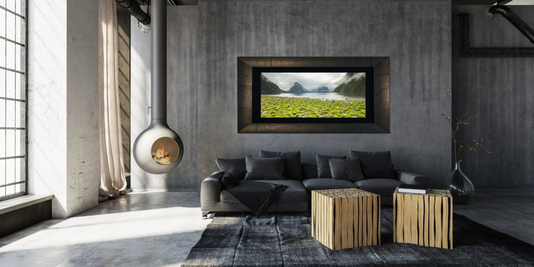 Framed large fine art print of bright green rocks in Milford Sound New Zealand displayed in modern stylish luxury home