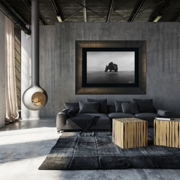 framed photo of Icelandic rock in ocean hanging in modern home