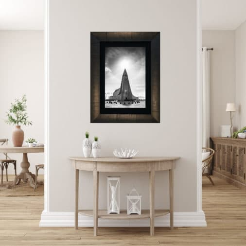 framed photo of Icelandic church with halo around the top from sun coming through the clouds displayed in modern stylish luxury home