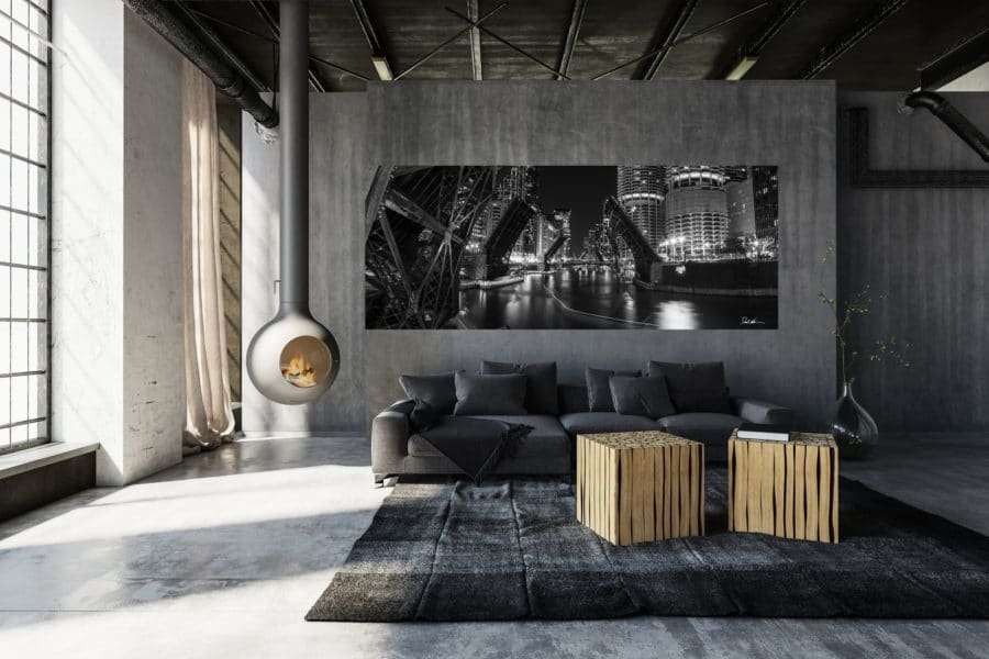 Black and white photo of bridges in Chicago up displayed above a couch in a modern luxury home