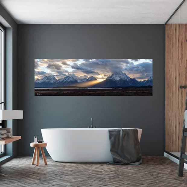 picture of Tetons at sunset above bathtub in luxury bathroom