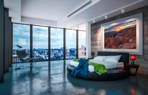 large framed photo of Bryce Canyon National Park at sunrise displayed in bedroom of luxury urban condo