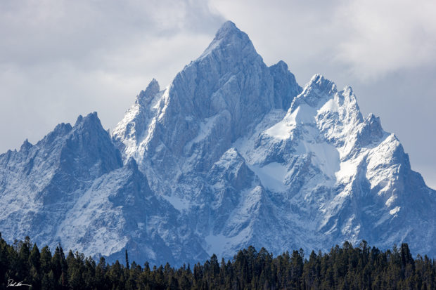 Photograph of towering snowy mountain in the Grand Teton National Park