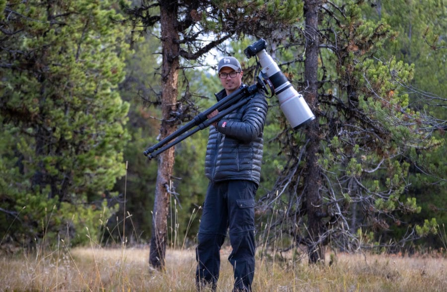 Photograph of photographer with large wildlife lens