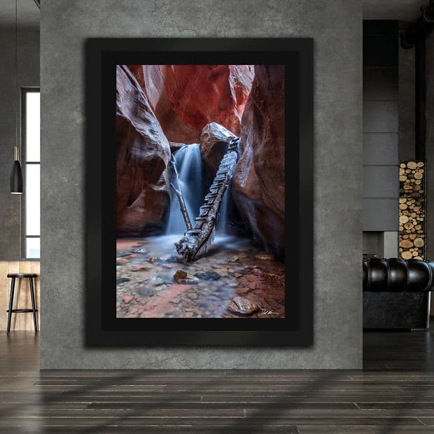 large framed image of waterfall in a canyon