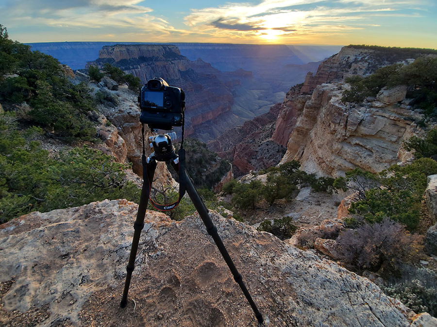 photo of a camera on top of a tripod at the edge of the Grand Canyon