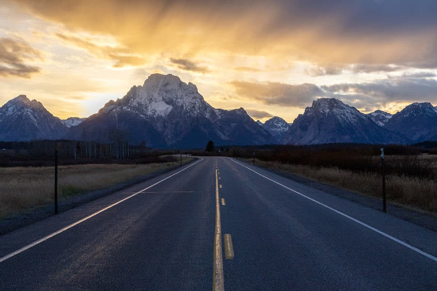 moody image of a road leading to GRAND TETON national park