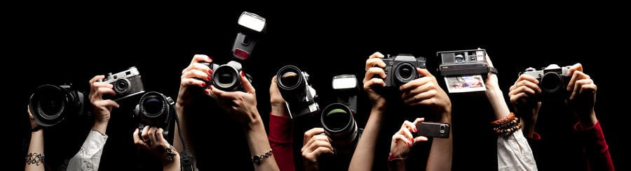 image of many cameras being held up