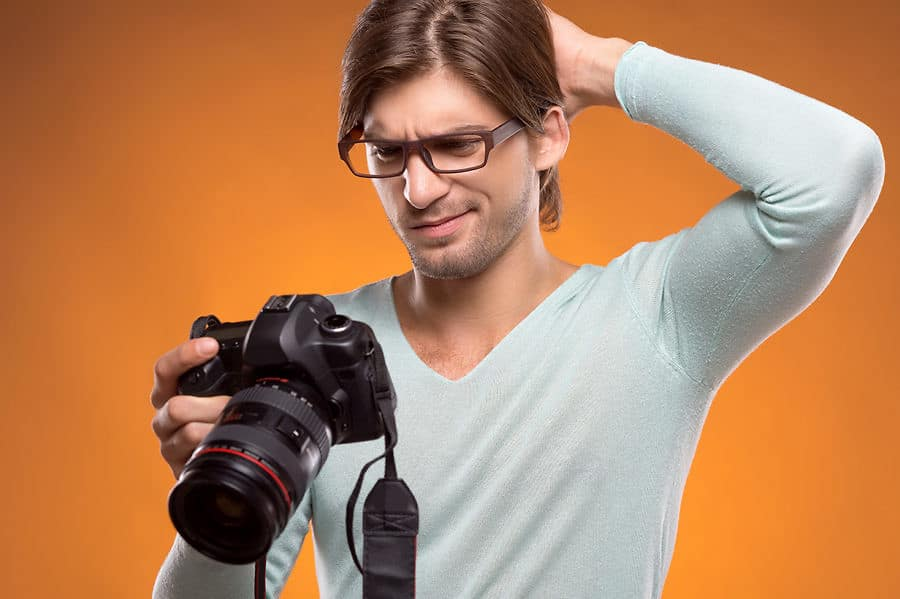 confused man looking at a camera