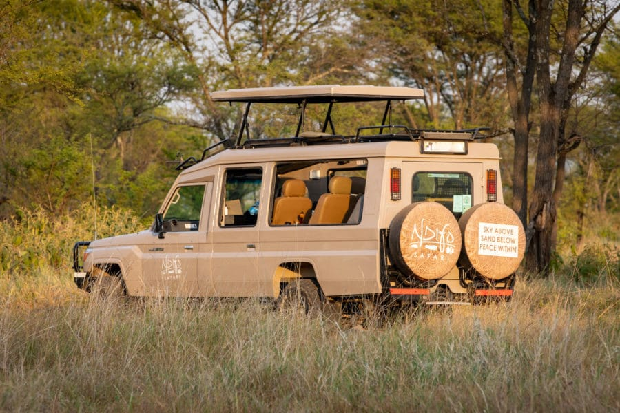 photo of a safari vehicle with top open and Ndifo wheel covers